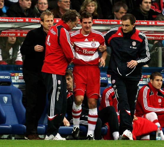 Miroslav Klose of Munich leaves the pitch after picking up an injury