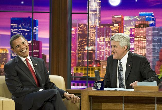 Barack Obama laughs as he speaks to host Jay Leno on his NBC late-night comedy show