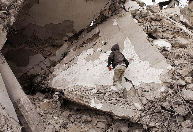 A boy runs through the ruins of a mosque damaged by Israeli troops on January 23, 2009 in a heavily damaged suburb in Gaza City