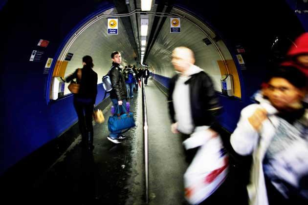 Touch and track: a passenger swipes her Oyster card to validate her journey at a London Underground station