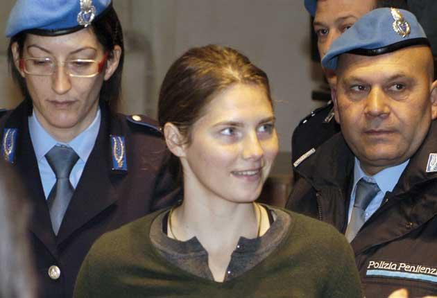 Amanda Knox arrives in court yesterday. Her stepfather has also been attending