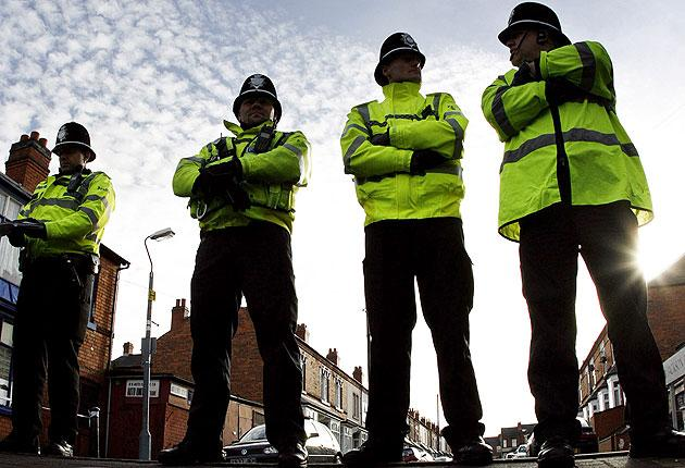 Police officers guard a Birmingham road after anti-terror arrests in 2007