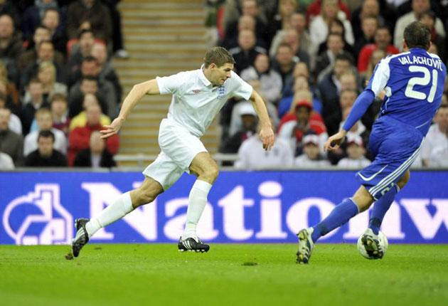 Steven Gerrard prepares to cross for Emile Heskey to score England's first goal at Wembley on Saturday