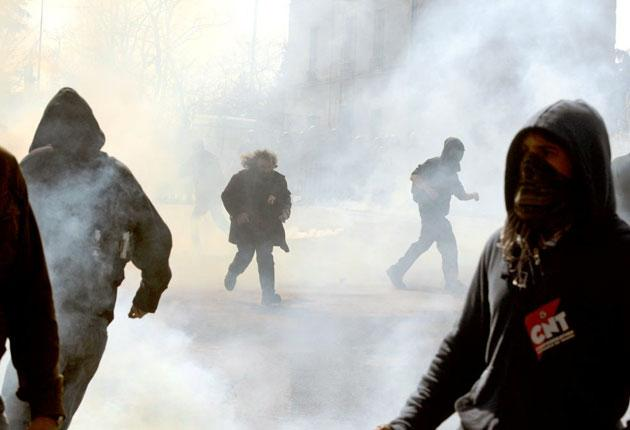 Protesters threw stones yesterday after President Sarkozy visited Chatellerault