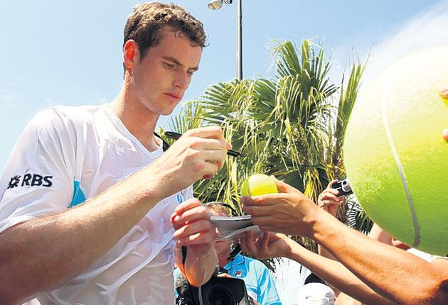 Andy Murray, who has lost just two matches this year, signs autographs after easily progressing to the quarter-finals in Miami