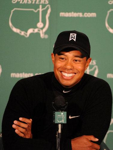 Tiger Woods smiles during yesterday's press conference at Augusta. 'I know I can win the Slam, I've done it before,' he said