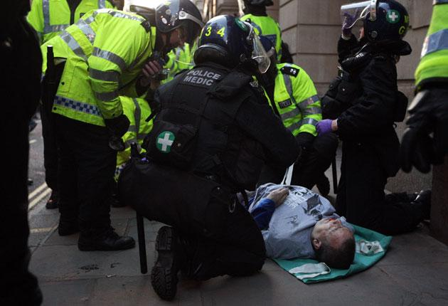 Ian Tomlinson being treated by medics after he collapsed during the G20 demonstration