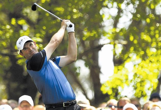 Padraig Harrington hits his tee shot on the par-three fourth during the first round at Augusta yesterday