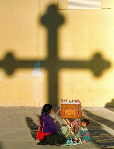 A mother and child are pictured outside the San Cristobal de las Casas Church in Chiapas