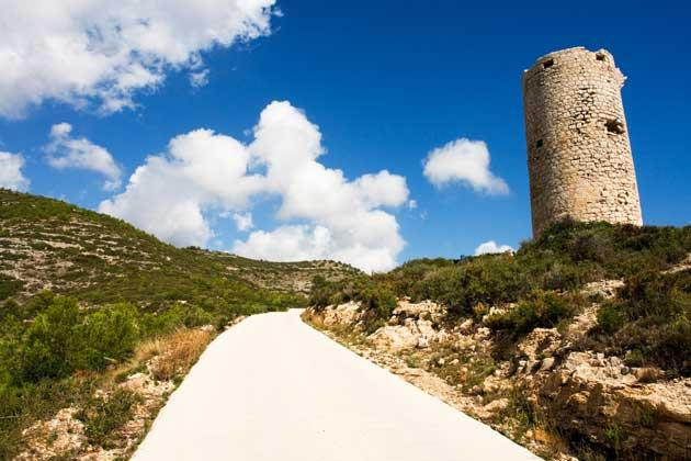Rocky road: a path winds past the Torre Badum watchtower
