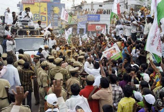 Indian screen legend Chiranjeevi, below, leader of the Praja Rajyam Party, is welcomed by fans in Andhra Pradesh