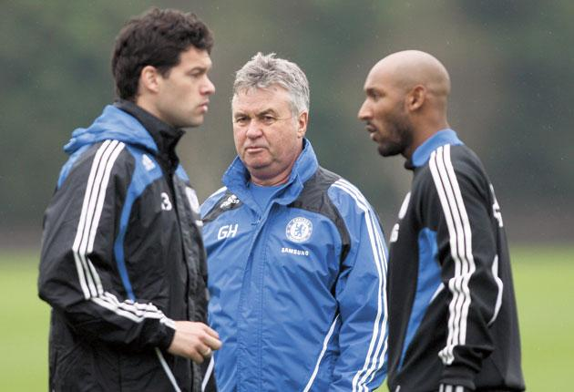 Guus Hiddink (centre) looks on yesterday as Nicolas Anelka and Michael Ballack (left) prepare for today's FA Cup semi-final