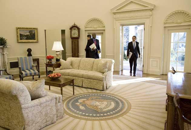 Testing times: Obama enters the Whitehouse on his first full day as president