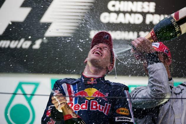 Button (right) came third behind the Red Bull's of Mark Webber and Sebastian Vettel, who won the race in China