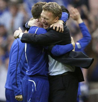 The Everton manager David Moyes (right) celebrates their FA Cup semi-final win against Manchester United with his captain Phil Neville
