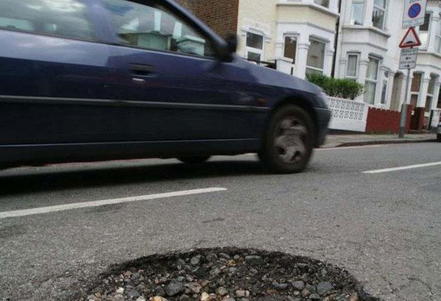 A pothole in Tooting, south London. Each one costs an average of £65 to fill
