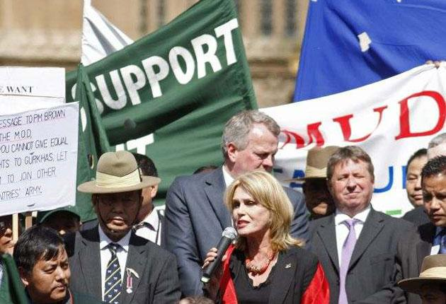 The actress Joanna Lumley celebrates outside the Houses of Parliament yesterday after the vote to grant equal residence to 36,000 Gurkha veterans