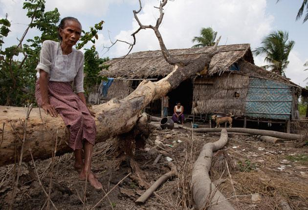 Daw Thaqn Myint, 70, outside her home in Pyinbogyi village. Thousands of Burmese still rely on aid after Cyclone Nargis