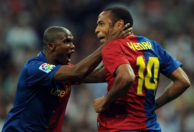 Thierry Henry celebrates with Barcelona team-mate Samuel Eto'o