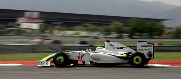Jenson Button speeds around the Circuit de Catalunya yesterday but concedes that the race to the first corner today 'could be a bit crazy'