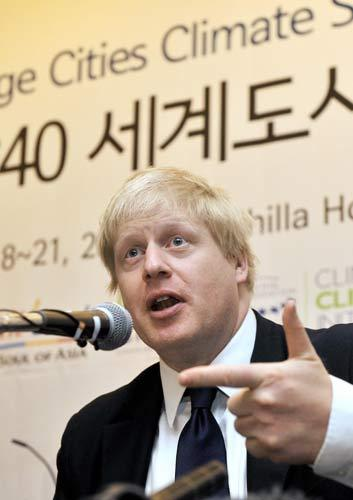 London Mayor Boris Johnson gestures during a press conference today at a hotel in Seoul where the C40 climate change conference will take place
