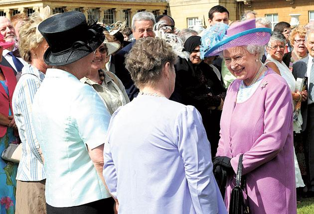 The Queen greets guests at a party in the grounds of Buckingham Palace last July