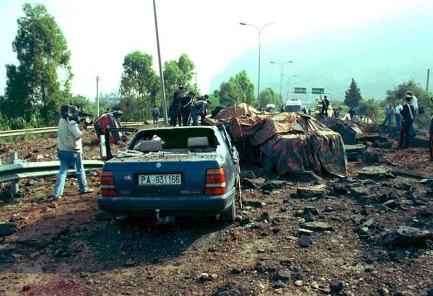 The scene after the car-bomb assassination of anti-Mafia judge Giovanni Falcone