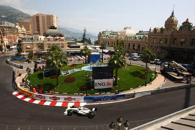 Jenson Button puts his car through its paces before racing to the front of the grid for the fourth time this season in Monte Carlo yesterday