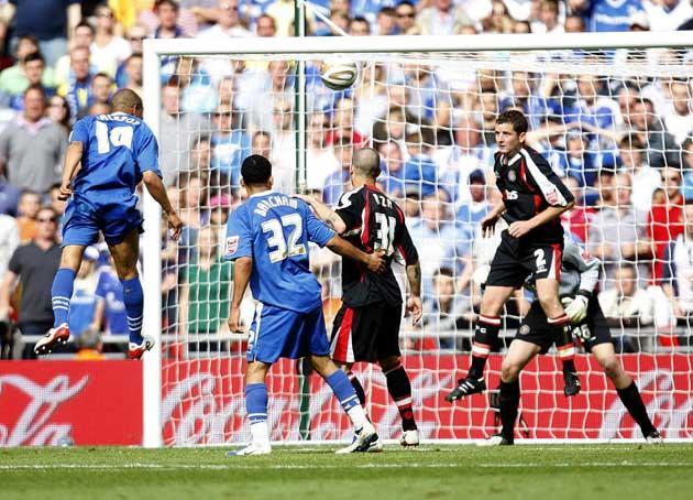 Simeon Jackson rises to convert Josh Wright's corner with Gillingham's last chance of the match