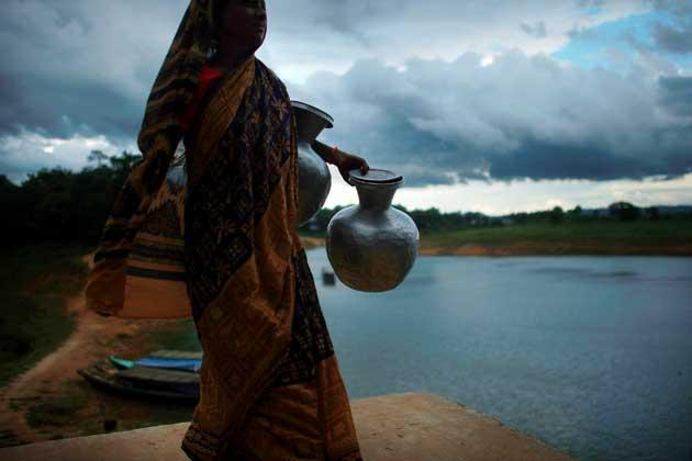 A woman collects water in the town of Rangamati, in the Chittagong Hill Tracts region of Bangladesh. Jihadist training bases are suspected to be in the area