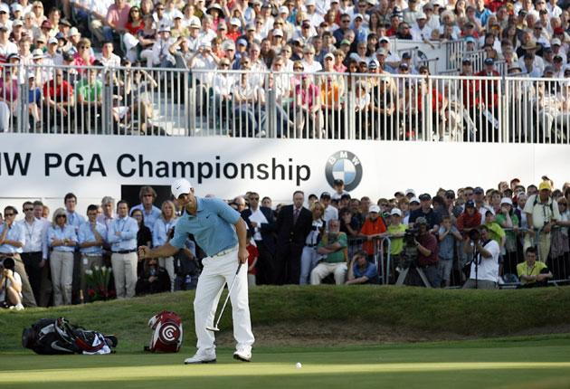 Paul Casey waits for his putt on the 18th to drop yesterday so he can be crowned PGA champion at Wentworth