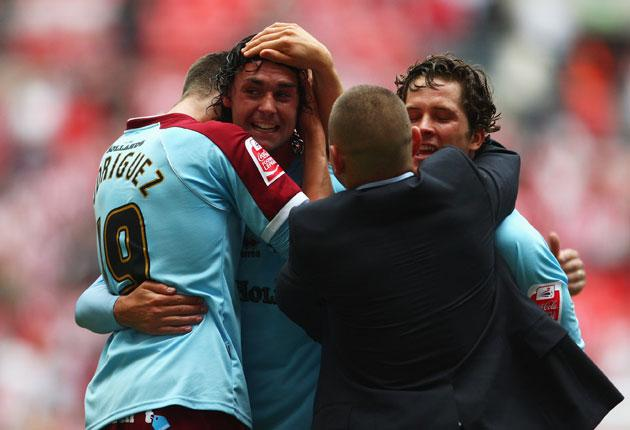 Burnley players and officials celebrate victory during the Coca-Cola Championship Playoff Final between Burnley and Sheffield United at Wembley Stadium