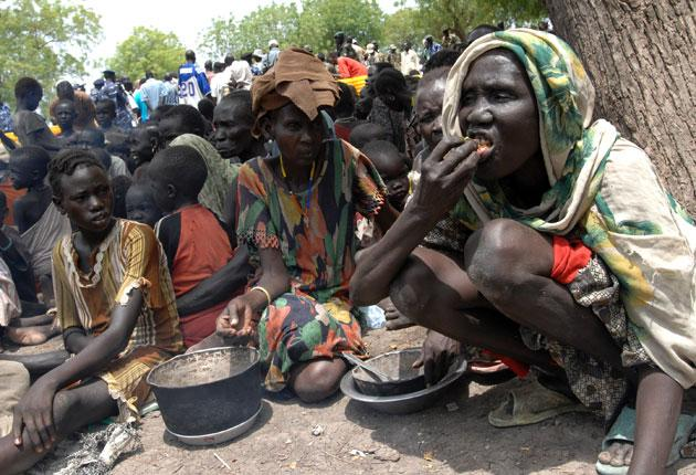 Refugees wait for food rations in southern Sudan. Omar al Bashir is retaining his stance against foreign aid agencies, which he expelled from the country