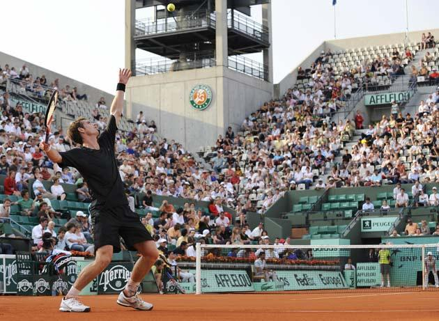 Andy Murray serves to Argentinian player Juan Ignacio Chela during their French Open tennis first round match