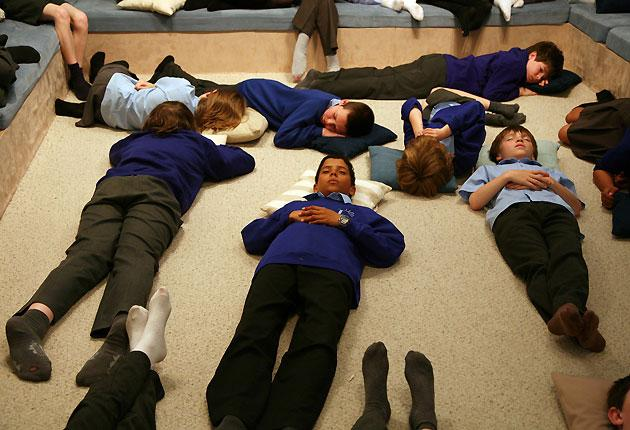 Meditation's what you need: children at Latchmere School in Kingston upon Thames practise their relaxation techniques. Many of the school's pupils value getting in touch with themselves