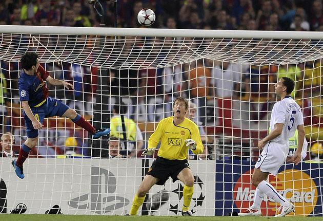 Lionel Messi beats Manchester United goalkeeper Edwin van der Sar to give Barcelona a 2-0 lead in the Champions League final
