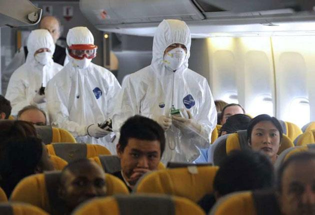 Chinese health authority inspectors enter a German aircraft in Shanghai