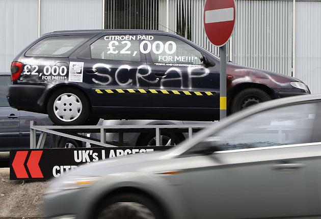 An old car displays the scrappage allowance at a Citroen showroom in Birmingham, central England