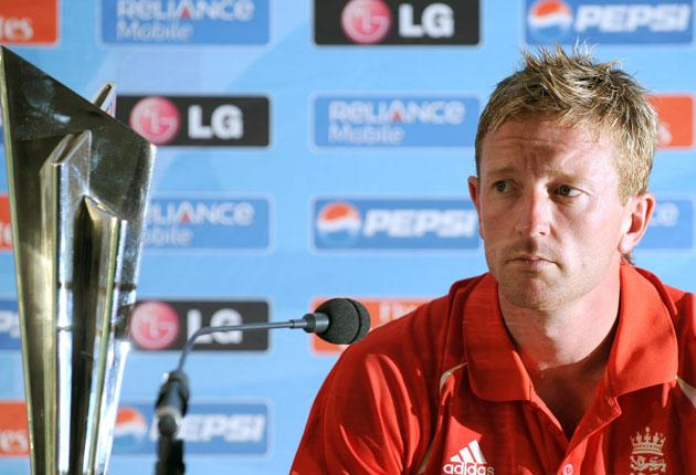 The England captain, Paul Collingwood, glances at the World Twenty20 trophy during a press conference to launch the team's challenge at Lord's yesterday