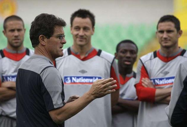 England coach Fabio Capello addresses his players during training in Almaty