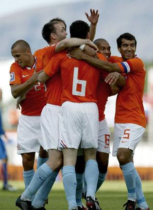 Nigel de Jong (second right) celebrates his first goal for the Netherlands