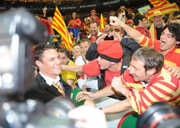 Perpignan's New Zealand fly half Dan Carter celebrates with fans after the French Top 14 rugby union final