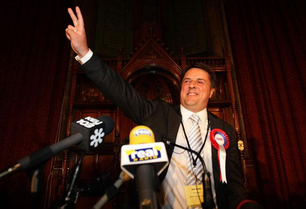 TheBNPLeader Nick Griffin celebrates after European parliamentary election results were announced at Manchester Town Hall