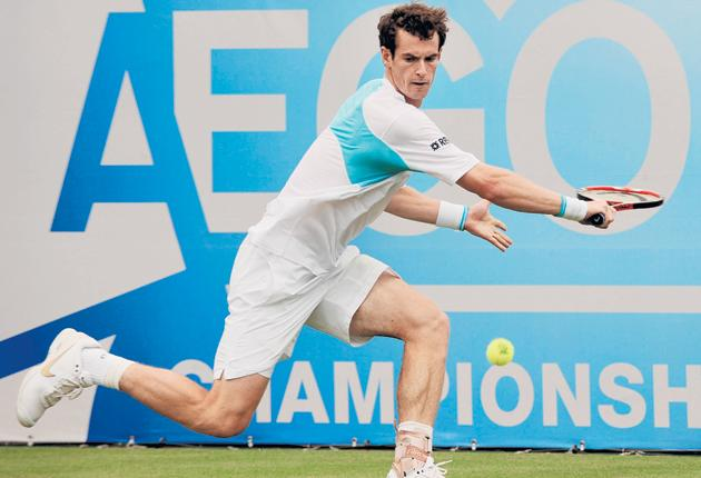 Andy Murray prepares to hit a backhand during his 6-1, 6-4 victory over Italy's Andreas Seppi at Queen's Club yesterday