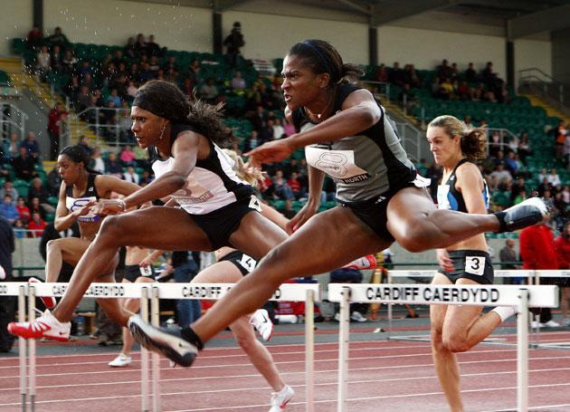 Tasha Danvers (centre), who was captaining London South, races to victory in the 100m hurdles of the city contest