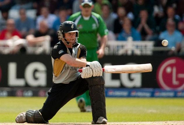 Aaron Redmond plays a switch hit during his quickfire 63 off just 30 balls for New Zealand against Ireland in the Super Eights yesterday