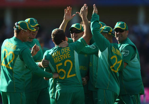 Roelof van der Merwe is congratulated by his South African team-mates after his dramatic catch to dismiss Kevin Pietersen