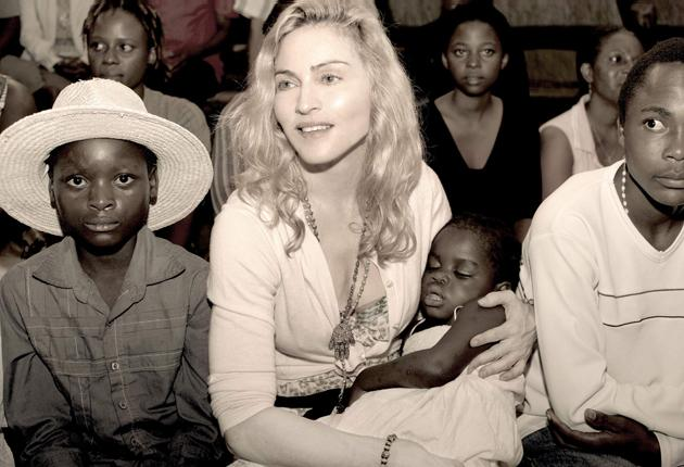 Madonna holds Mercy on a recent visit to Malawi. The singer's legal fight to adopt the child has dragged on for three years