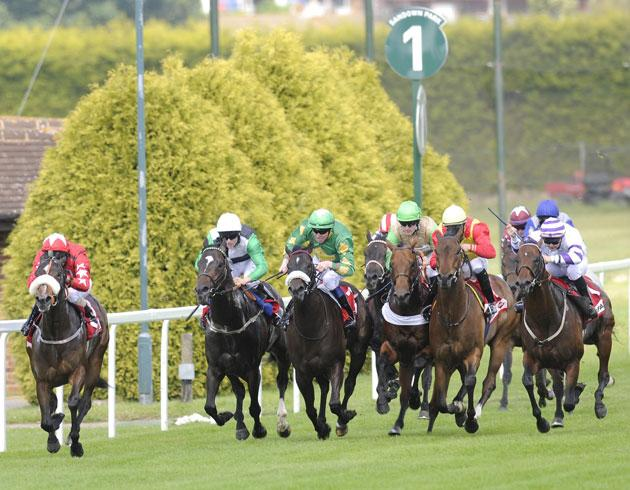Triple Aspect ridden by Liam Jones (far right) goes on to win the Scurry Stakes at Sandown yesterday