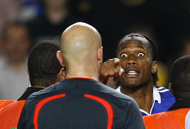 Didier Drogba confronts referee Tom Henning Ovrebo after Chelsea's exit from the Champions League semi-finals against Barcelona last month